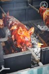 Suckling pig being roasted at Hoy Pinoy