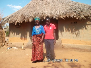 Mrs. Tichoke Phiri with her son, Kenneth, at their homestead in Kawalala Camp, Katete District Photo credit: Cannon Mukuma/IITA
