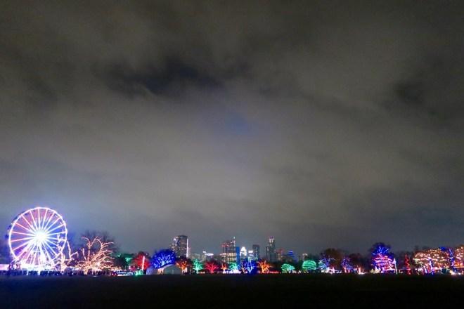 trail of lights under austin skyline