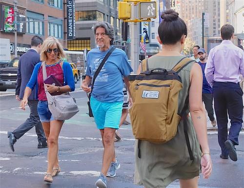 Tourists actually smile when you take their photo...