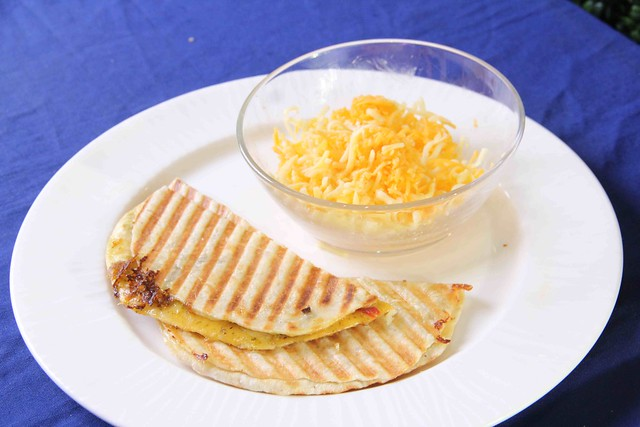 Cheese Quesadilla used the Moulinex Food Shredder for the even grating of the cheese and Krups Griddle to cruncnh up the French Baker tortilla wraps