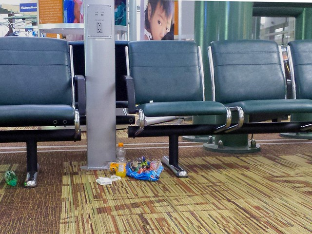 airport annoyances - people leaving trash behind and not treading lightly