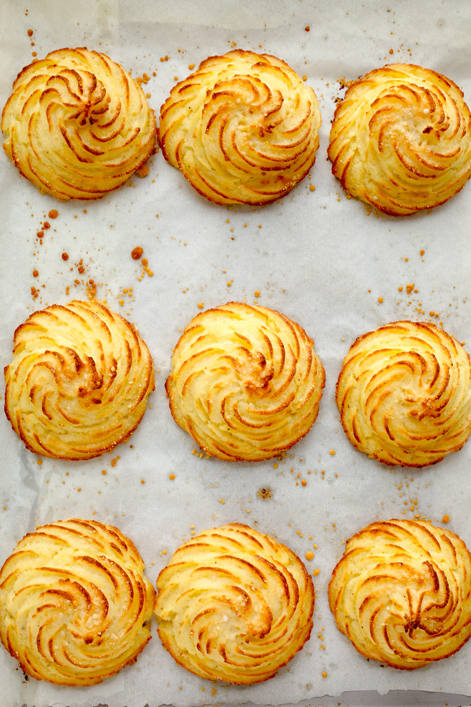 baked parmesan duchess potatoes on baking sheet