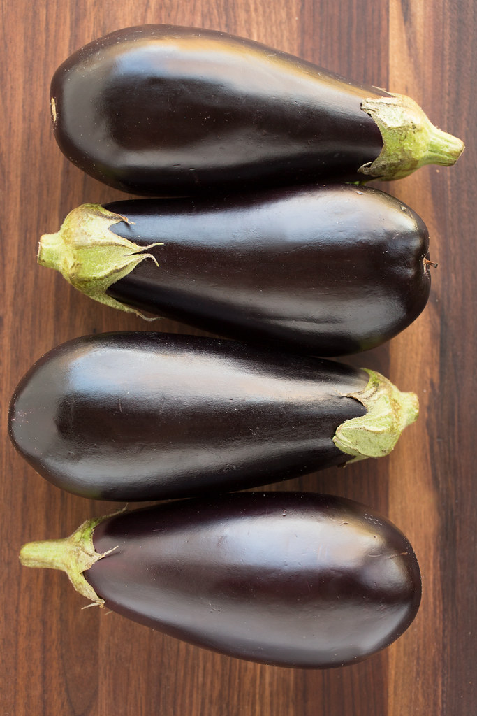 Eggplant lined up on board