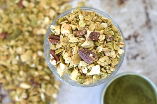Overhead photo of maple matcha granola in a glass.