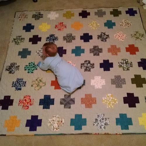 You guuuuys!!! It's done. Labeled, washed, and ready to be gifted! Plus bonus baby. We haven't decided if we're gifting him too. :D #gifts #quilting #process #moderncrosses