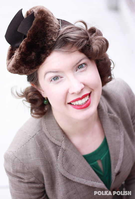 Brown I. Magnin blazer with green Bakelite earrings and a brown 1940s sheared fur tilt hat