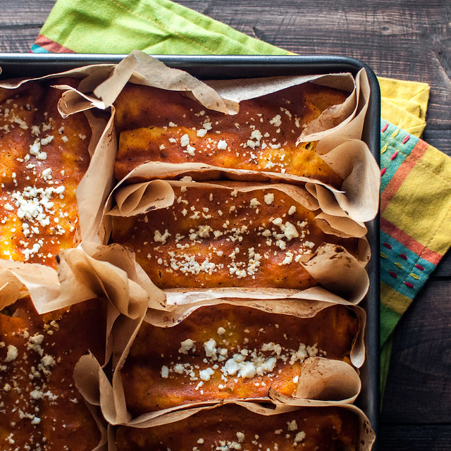fiesta veggie enchiladas in individual parchment squares, for easy serving, cleanup, and freezing!