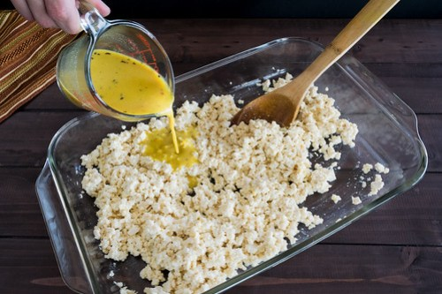 adding cheese sauce to the tofu