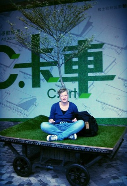 sitting in the grass in Hong Kong