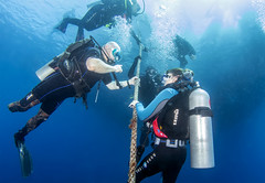 BK amputee diving instructor and diver on a safety stop 3