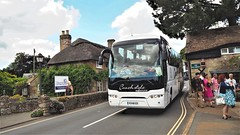 Squeezing Through The VIllage of Godshill.