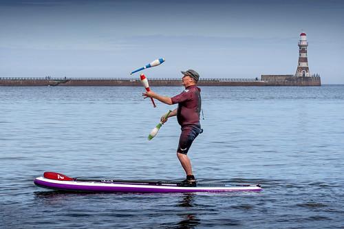Juggling paddle-boarder, Roker, Sunderland