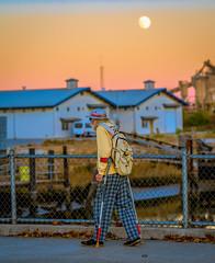 Old Man Crosses Bridge at Moonrise