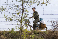 A North Korean civilian is seen riding bicycle on the eastern bank of Yalu River from Dandong, Liaoning Province, China on October 29, 2018. (Photo by Yichuan Cao/Sipa USA)