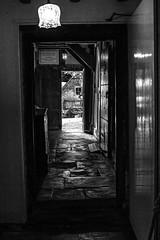 Well-worn and Dark Corridor.