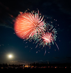 a moon with Fireworks