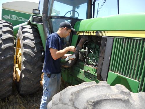 James checking oil