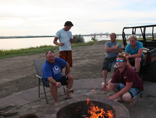 Dad, Oak, and Callum make toasted marshmallows.