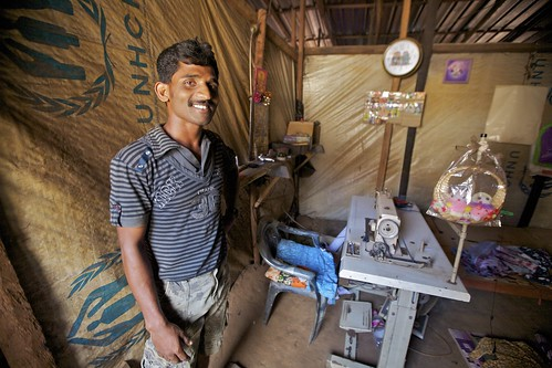 A taylor from Mannar who moved to get married in Trincomalee, now running his business out of the IDP camp in Mutthur