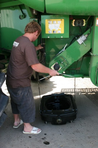 Johan prepare to change the oil on the combine