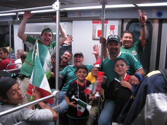 Fans celebrating on the Gold Line. Go Metro!