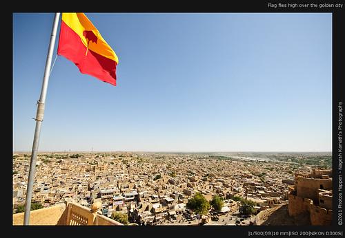 Flag flies high over the golden city
