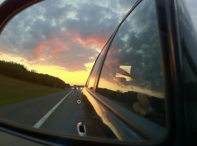 Photo from the passenger seat - sunset in the mirror