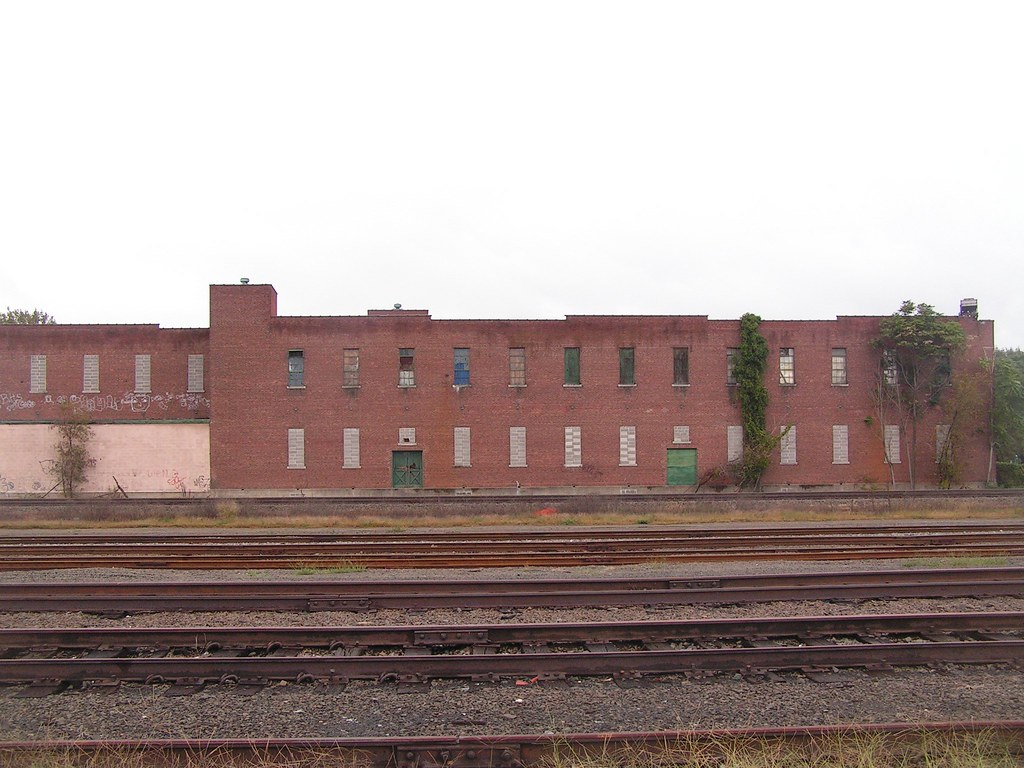 Large red building, with tracks