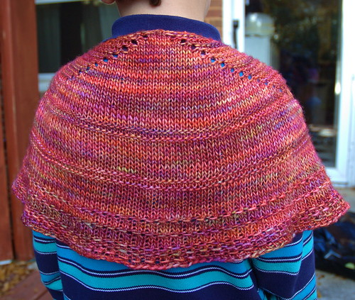 A pink handknitted child's shawl