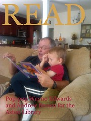 Pop-pop Wayne Edwards reading to Andrew Brown