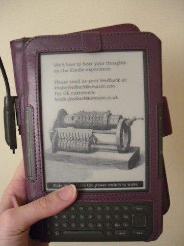 Held in cover ready for reading (cover flap not secure)