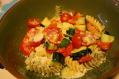 pasta with zucchini, parmesean cheese, cherry tomatoes, red peppers