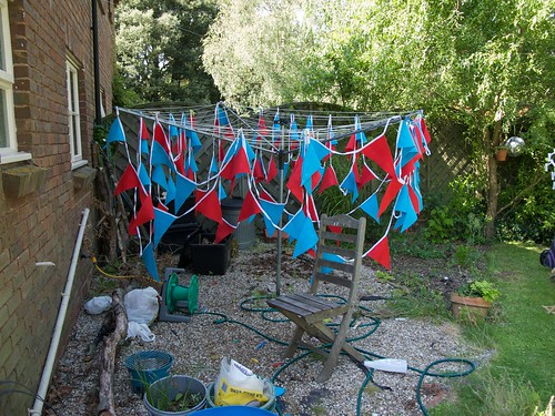 Bunting, sprayed with fire-retardent, drying on the clothes line