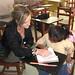 volunteer helping student with homework