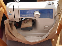Packing away the sewing machine into its prote...