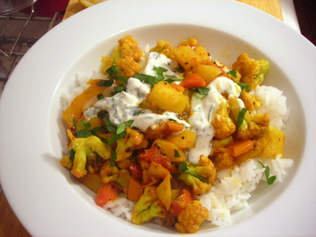 Aloo gobi with mint-cilantro raita over steamed jasmine rice