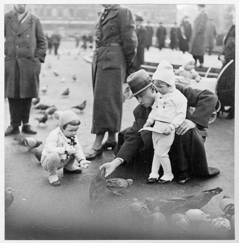 Children feeding pigeons in Leipzig, Germany 1937