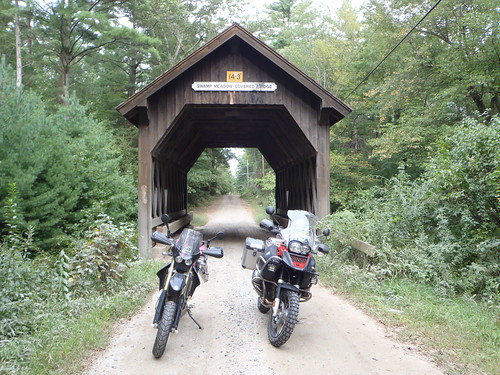 Still life with BMW 1200 GSA and DRZ400SM with only covered bridge in Rhode Island