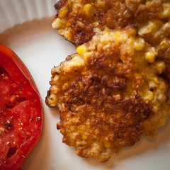 Corn fritters and beefsteak tomatoes