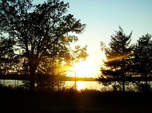 sun setting over the lake
