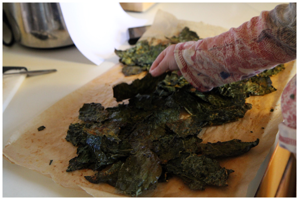 Making kale chips together from scratch