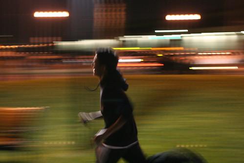 man running through the night in SF