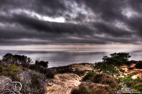 Another HDR of a distant sunset with an overcast sky @ the torrey pines beach by skhimsara