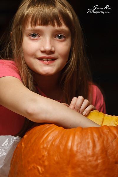 The big one guts her pumpkin as well.