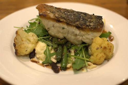 Crisp skin barramundi with green beans, spiced cauliflower puree, wild rocket, raisins and flaked almonds, and a caramelised balsamic dressing