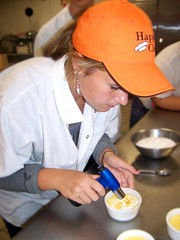 Student Haylee Chute finishes preparing a dessert at Oxford Hills Technical School in Norway, Maine.