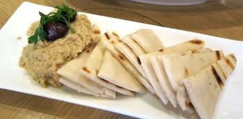 Hummus dip with warm pita bread