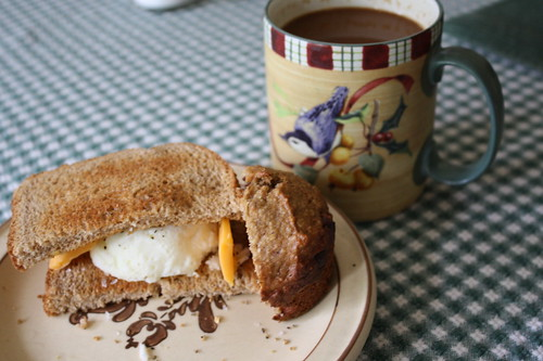 breakfast 8-6-11, poached egg, coffee, half of a muffin