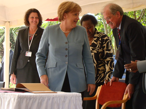 Merkel visits ILRI Nairobi: Signing ILRI's visitors' book